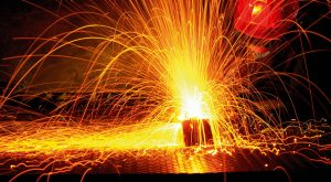 Worker welding with gas torch